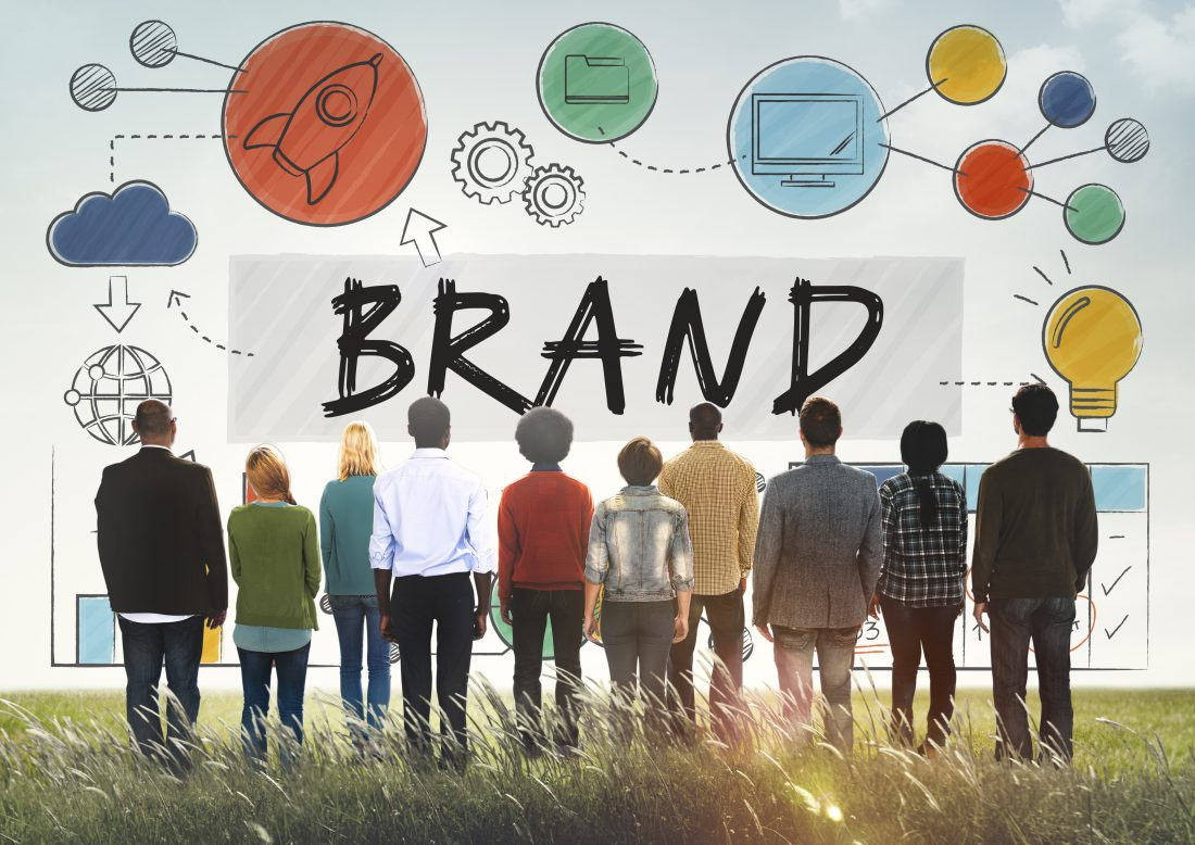 "people standing in front of ""BRAND"" to signify brand architecture models"